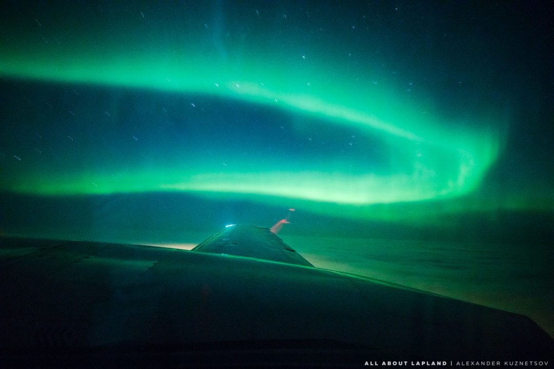 Northern lights flight in Rovaniemi Lapland Finland goes above the clouds to reveal aurora borealis. Photo by Alexander Kuznetsov / All About Lapland.