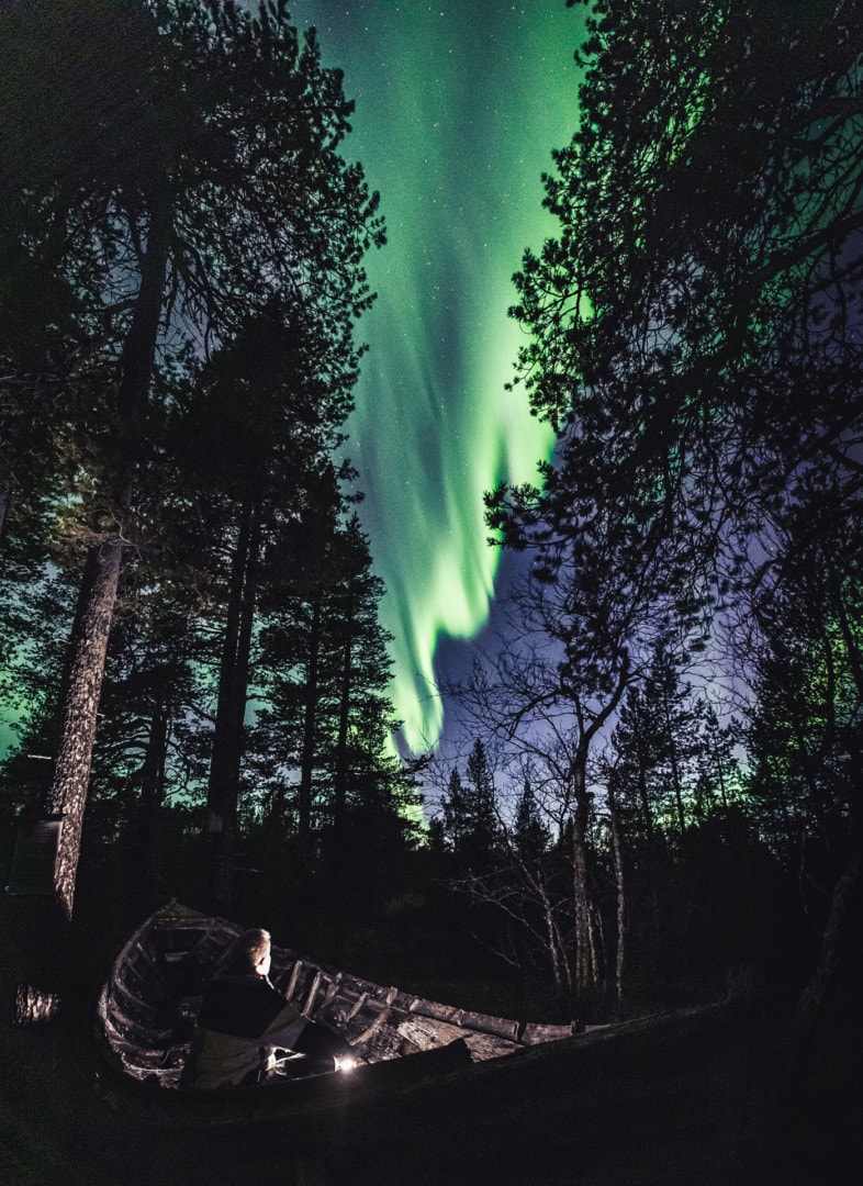Alexander Kuznetsov watching the Northern Lights in Ivalo Lapland Finland.