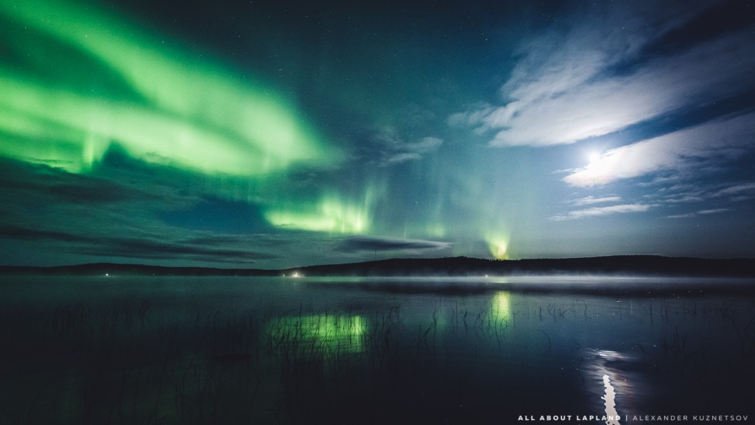 Beautiful northern lights over a lake in September, Rovaniemi Lapland Finland.