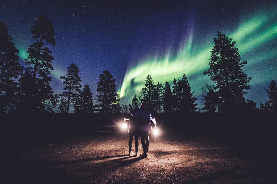 Mattia and Heini Bonagura watching Northern Lights in ivalo Lapland Finland. Photo by Alexander Kuznetsov / Aurora Hunting