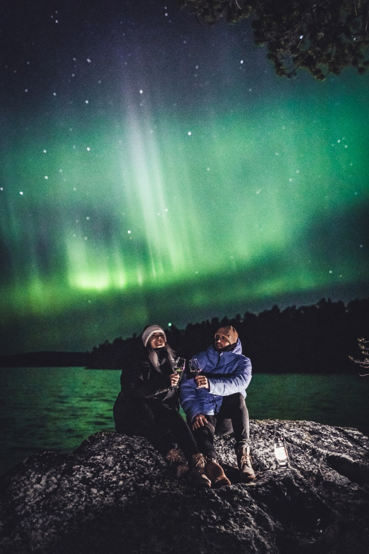 Romantic moment under the Northern Lights in ivalo Lapland Finland. Photo by Alexander Kuznetsov / Aurora Hunting